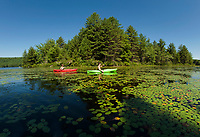 Paddlers on Lake Wicwas.  (Karen Bobotas/for the Laconia Daily Sun)