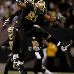 2009 November 02: New Orleans Saints defensive end Will Smith (91) celebrates with defensive end Anthony Hargrove (69) after sacking Atlanta Falcons quarterback Matt Ryan (2) during the first half at the Louisiana Superdome in New Orleans, Louisiana.