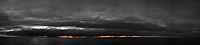 Orange Light Under the Clouds. Panorama from the aft deck of the MV World Odyssey. Composite of 15 mages taken with a Fuji X-T1 cameera and 35 mm f/1.4 lens (ISO 200, 35 mm, f/1.4, 1/30 sec). Raw images processed with Capture One Pro and AutoPano Giga Pro.