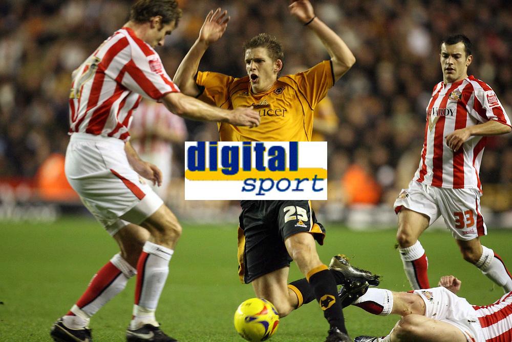 Photo: Rich Eaton.<br /> <br /> Wolverhampton Wanderers v Sunderland. Coca Cola Championship. 24/11/2006. Daniel Jones of Wolves is tackled by the Sunderland defence