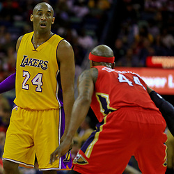 Apr 8, 2016; New Orleans, LA, USA; Los Angeles Lakers forward Kobe Bryant (24) is defended by New Orleans Pelicans forward Dante Cunningham (44) during the first quarter of a game at the Smoothie King Center. Mandatory Credit: Derick E. Hingle-USA TODAY Sports