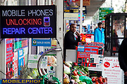 Mobile phone unlocking centre on Edgware Road, London. This is a predominantly Middle Eastern / Arabic area of London.