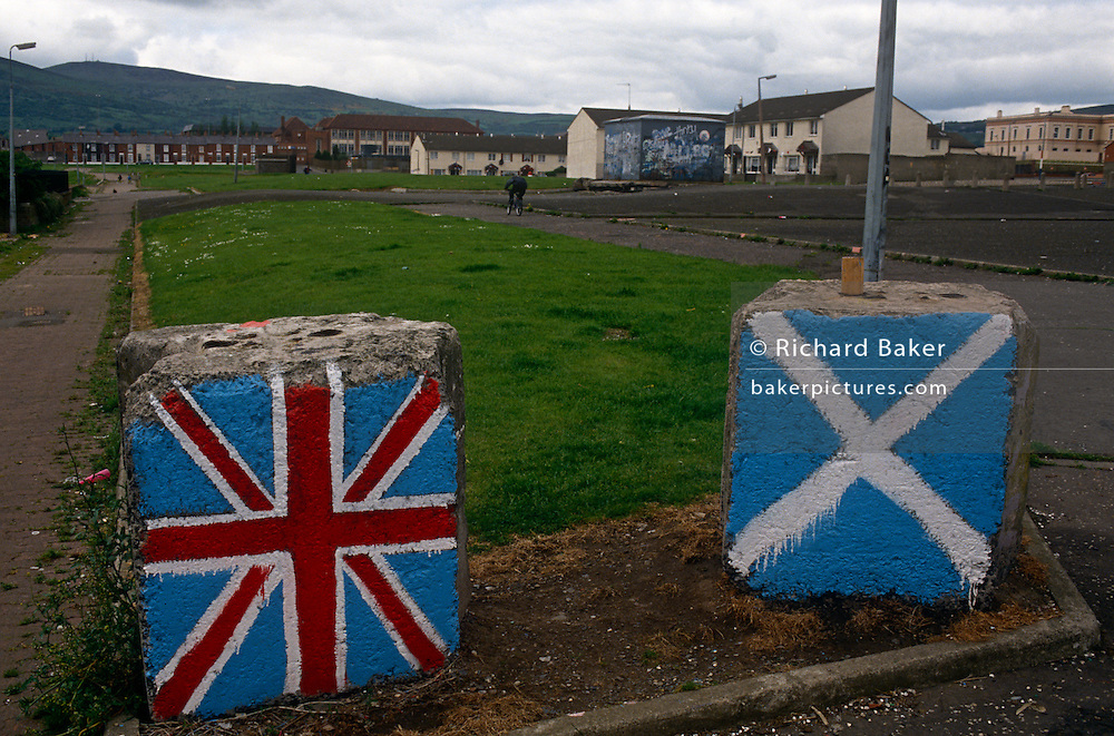 Concrete blocks painted in the colours of the Union Jack and the Scottish Saltire on a Protestant loyalist estate off the Shankill Road in Belfast, northern Ireland.