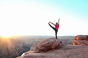 Young woman doing Yoga at Horseshoe Bend Colorado River Arizona USA