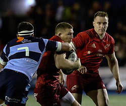 Andrew Conway of Munster is tackled by Ellis Jenkins of Cardiff Blues<br /> <br /> Photographer Simon King/Replay Images<br /> <br /> Guinness PRO14 Round 4 - Cardiff Blues v Munster - Friday 21st September 2018 - Cardiff Arms Park - Cardiff<br /> <br /> World Copyright © Replay Images . All rights reserved. info@replayimages.co.uk - http://replayimages.co.uk