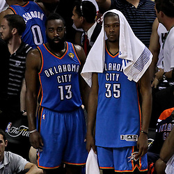Jun 21, 2012; Miami, FL, USA; Oklahoma City Thunder guard James Harden (13) and small forward Kevin Durant (35) react against the Miami Heat during the fourth quarter of the 2012 NBA Finals against the Oklahoma City Thunder at the American Airlines Arena. Miami won 121-106. Mandatory Credit: Derick E. Hingle-US PRESSWIRE
