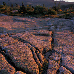Acadia National Park, ME..Grooves in the granite on the summit of Cadillac Mountain.  Porcupine Islands are in the distance.