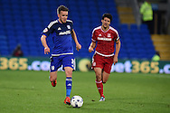 Craig Noone  of Cardiff city (l) in action. Skybet football league championship match, Cardiff city v Middlesbrough at the Cardiff city Stadium in Cardiff, South Wales  on Tuesday 20th October 2015.<br /> pic by  Andrew Orchard, Andrew Orchard sports photography.