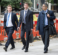 © London News Pictures. 26/09/2013 . London, UK. VLADIMIR ANTONOV (centre) arriving at Westminster Magistrates Court in London for the start of his full extradition hearing. Antonov, who is the former owner of Portsmouth Football Club, and his business partner Raimondas Baranauskas, are accused of asset stripping hundreds of millions of pounds from Snoras Bank. Photo credit : Ben Cawthra/LNP