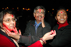 Family enjoying the Hindu Holi festival; celebration of colours,