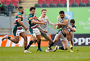 Wasps Winger Zach Kibirige is held by Leicester Tigers centre Matt Scott during a Gallagher Premiership Round 10 Rugby Union match, Friday, Feb. 20, 2021, in Leicester, United Kingdom. (Steve Flynn/Image of Sport)