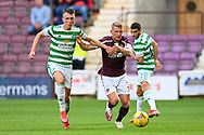David Turnbull (#14) of Celtic FC and Stephen Kingsley (#3) of Heart of Midlothian FC tussle for the ball during the Cinch SPFL Premiership match between Heart of Midlothian FC and Celtic FC at Tynecastle Park, Edinburgh, Scotland on 31 July 2021.