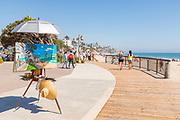 Artist Painting Easel on Main Beach Boardwalk in Laguna