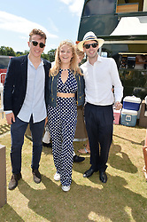 Left to right, GEORGE POSTLETHWAITE, ELLA STOPFORD-SACKVILLE and KAI CORFIELD at the Jaeger-LeCoultre Gold Cup Polo Final held at Cowdray Park Polo Club, Midhurst, West Sussex on 19th July 2015