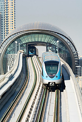 Metro train on elevated track in Dubai United Arab Emirates