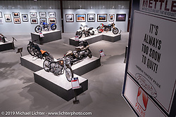Thematic quote banners hang above the More Mettle - Motorcycles and Art That Never Quit exhibition in the Buffalo Chip Events Center Gallery during the Sturgis Motorcycle Rally. SD, USA. Wednesday, August 11, 2021. Photography ©2021 Michael Lichter.