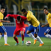 Brazil's Roberto Firmino (R) during their a international friendly soccer match Turkey betwen Brazil at Sukru Saracoglu Arena in istanbul November 12, 2014. Photo by Aykut AKICI/TURKPIX