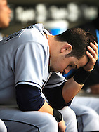 Tampa Bay Rays rookie Evan Longoria holds his head in his hand as his team loses for the sixth straight time July 12, 2008 in Cleveland. The Rays lost their last seven games before the all-star break..