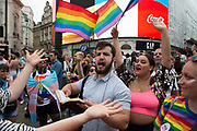A man holding a bible shouts at party goers telling them God will send them to hell for unnatural acts of love as members of the Lesbian, Gay, Bisexual and Transgender (LGBT) community take part in the annual Pride Parade on 6th July, 2019 in London,United Kingdom. (photo by Claire Doherty/In Pictures via Getty Images)