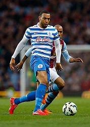 Matt Phillips of QPR is challenged by Fabian Delph of Aston Villa - Photo mandatory by-line: Rogan Thomson/JMP - 07966 386802 - 07/04/2015 - SPORT - FOOTBALL - Birmingham, England - Villa Park - Aston Villa v Queens Park Rangers - Barclays Premier League.