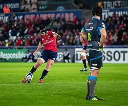 Tyler Bleyendaal of Munster  kicks a penalty<br /> <br /> Photographer Simon King/Replay Images<br /> <br /> European Rugby Champions Cup Round 1 - Ospreys v Munster - Saturday 16th November 2019 - Liberty Stadium - Swansea<br /> <br /> World Copyright © Replay Images . All rights reserved. info@replayimages.co.uk - http://replayimages.co.uk