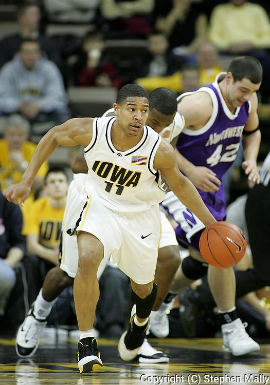 15 FEBRUARY 2007: Iowa guard Tony Freeman (11) drives down court in Iowa's 66-58 win over Northwestern at Carver-Hawkeye Arena in Iowa City, Iowa on February 15, 2007.
