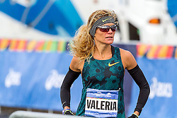 NYC Marathon, 38 year old Italian Valeria Straneo shows  nervous tension at the start of a long cold day in which she led several times in the first 18 miles