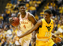 Jan 20, 2018; Morgantown, WV, USA; Texas Longhorns forward Mohamed Bamba (4) drives and shoots while guarded by West Virginia Mountaineers forward Lamont West (15) during the first half at WVU Coliseum. Mandatory Credit: Ben Queen-USA TODAY Sports