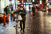 March 19, 2020, England, United Kingdom: A man wearing a face protective mask in central London's China Town is seen walking on Thursday, March 19, 2020. For most people, the new coronavirus causes only mild or moderate symptoms, such as fever and cough. For some, especially older adults and people with existing health problems, it can cause more severe illness, including pneumonia. (Photo/Vudi Xhymshiti) wearing a face protective mask in central London is seen walking in the street on Saturday, March 21, 2020. For most people, the new coronavirus causes only mild or moderate symptoms, such as fever and cough. For some, especially older adults and people with existing health problems, it can cause more severe illness, including pneumonia. (Credit Image: © Vedat Xhymshiti/ZUMA Wire)