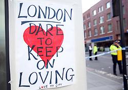 A poster near Borough Market in London following Saturday's terrorist attack.