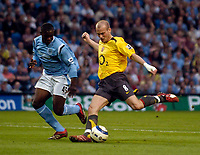 Photo: Jed Wee.<br /> Manchester City v Arsenal. The Barclays Premiership. 04/05/2006.<br /> <br /> Arsenal's Freddie Ljungberg (R) opens the scoring as he shoots past Manchester City's Micah Richards.