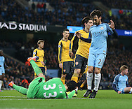Petr Cech of Arsenal saves at the feet of David Silva of Manchester City during the English Premier League match at the Etihad Stadium, Manchester. Picture date: December 18th, 2016. Picture credit should read: Simon Bellis/Sportimage