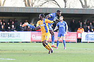 Craig Westcarr of Mansfield Town gets the better of Karleigh Osborne of AFC Wimbledon  during the Sky Bet League 2 match between AFC Wimbledon and Mansfield Town at the Cherry Red Records Stadium, Kingston, England on 16 January 2016. Photo by Stuart Butcher.