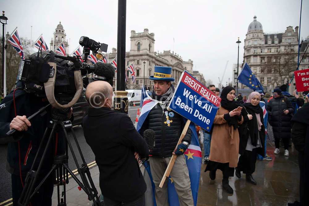 Media interview Steve Bray, founder of campaign group Sodem Stand of Defience European Movement outside the Houses of Parliament in Parliament Square, Westminster, on 30th January 2020, in London, England, United Kingdom. The United Kingdom will leave the European Union formally at 23:00 GMT on 31st January, 2020.