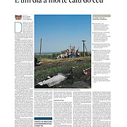 """Tearsheet of """"Ukraine: um dia a morte cai do ceu"""" published in Expresso"""