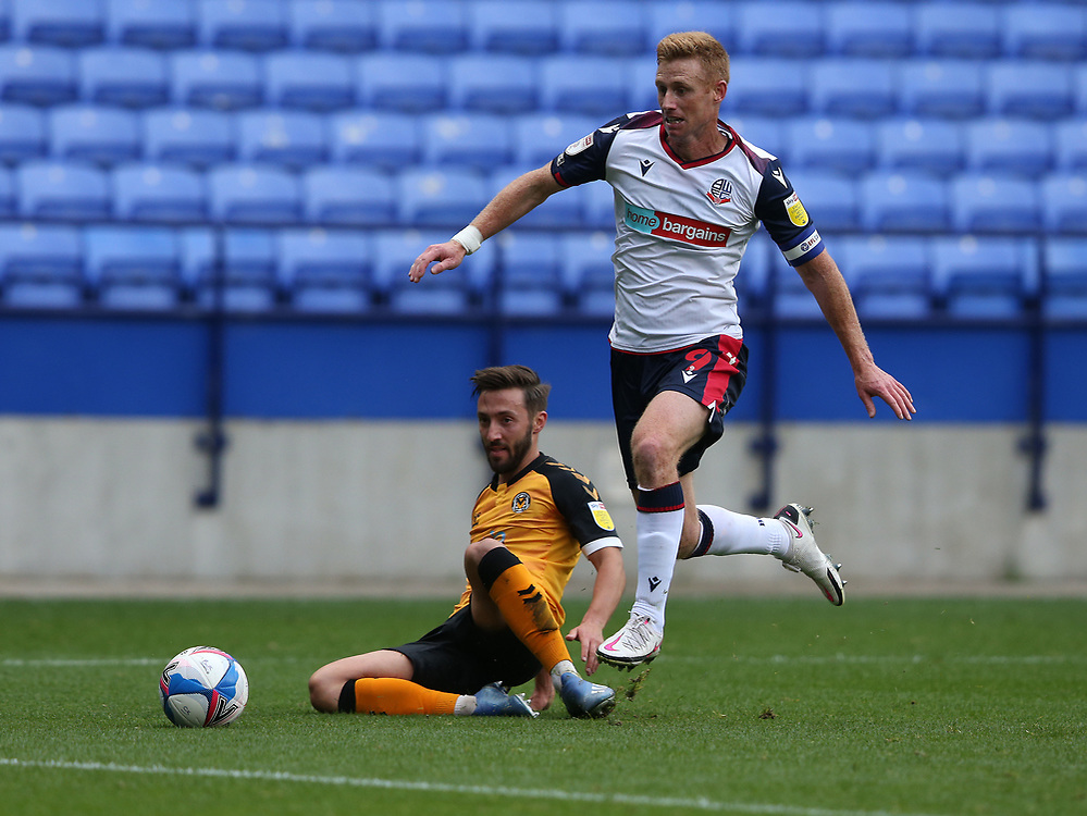 Bolton Wanderers' Eoin Doyle and Newport County's Josh Sheehan<br /> <br /> Photographer Stephen White/CameraSport<br /> <br /> The EFL Sky Bet League Two - Bolton Wanderers v Newport County - Saturday 26th September 2020 - University of Bolton Stadium - Bolton<br /> <br /> World Copyright © 2020 CameraSport. All rights reserved. 43 Linden Ave. Countesthorpe. Leicester. England. LE8 5PG - Tel: +44 (0) 116 277 4147 - admin@camerasport.com - www.camerasport.com