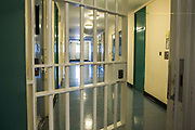 The gate into a corridor inside Beaufort House, a skill development unit for enhanced prisoners. Part of HMP/YOI Portland, a resettlement prison with a capacity for 530 prisoners.Dorset, United Kingdom.
