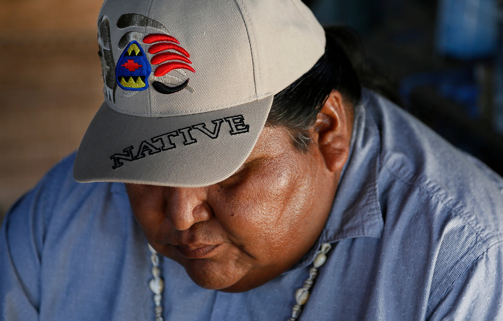 Verlon Jose, vice-chairman of the Tohono O'odham Nation (L,) pauses on his cousin's family ranch near the U.S.- Mexico border on the Tohono O'odham reservation in Chukut Kuk, Arizona April 6, 2017. Picture taken April 6, 2017.  REUTERS/Rick Wilking