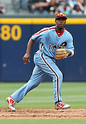 ATLANTA, GA - MAY 15:  Shortstop Jimmy Rollins #11 of the Philadelphia Phillies moves to make a play during the MLB Civil Rights Game between the Philadelphia Phillies and the Atlanta Braves on Sunday, May 15, 2011 at Turner Field in Atlanta, Georgia.  (Photo by Mike Zarrilli/MLB Photos via Getty Images)