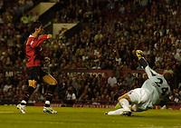 Fotball<br /> England 2005/2006<br /> Foto: SBI/Digitalsport<br /> NORWAY ONLY<br /> <br /> Manchester United v Debrecen VSC. UEFA Champions League Qualifier.<br /> 09/08/2005.<br /> <br /> Manchester United's Cristiano Ronaldo (L) scores his team's third goal.