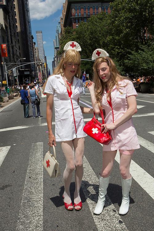 Two male cross-dressers wear women's nurses's costumes.