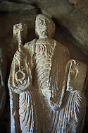 """Early Anglo Saxon sulpture of the St Peter now part of the south porch of Malmesbury Abbey, Wiltshire, England. The apostles, apart from Peter who holds a crude key, have no distinguishing feature to allow identification. Some are holding books, none have halos and some hold their heads at awkward angles and the statue of Peter has no beard. These  styles are typical of Anglo Saxon art. The two panels are 10 ft long and 4ft 6"""" high are date from the original Ango Saxon church of 705. They were probablbly built into the proch during the Norman rebuilding. The style of these sculptures is of the Roman Byzantine style and were probably sculpted by masions from Gaul.  Malmesbury Abbey, Wiltshire, England .<br /> <br /> Visit our MEDIEVAL PHOTO COLLECTIONS for more   photos  to download or buy as prints https://funkystock.photoshelter.com/gallery-collection/Medieval-Middle-Ages-Historic-Places-Arcaeological-Sites-Pictures-Images-of/C0000B5ZA54_WD0s"""