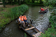 Visitors try out a lake pedalo at Chateau de Clos Lucé, home to Leonardo da Vinci for the last 3 years of his life and now a celebration of his life and achievements, Amboise, France.