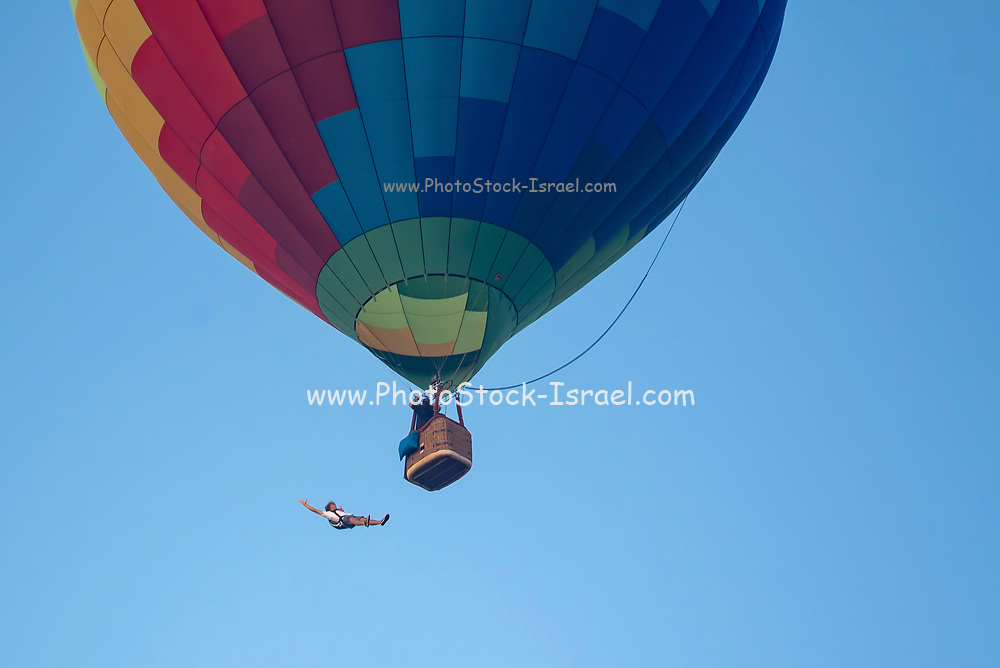 skydiver jumps out of a hot air balloon