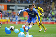 Fernando Torres of Chelsea catches Cardiff goalkeeper David Marshall out with this first half attempt on goal.<br /> <br /> pic by Phil Rees, Andrew Orchard sports photography.