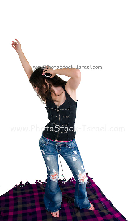 Young woman enjoys music on her headphones