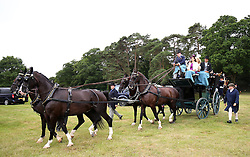 Racegoers in a horse drawn carriage during day two of Royal Ascot at Ascot Racecourse.
