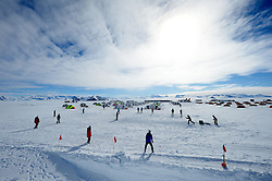"""© Licensed to London News Pictures. Union Glacier, Antarctica. Competitors from the Antarctic Ice Marathon play a game of impromptu """"Ashes"""" cricket at the Union Glacier camp, Antarctica ahead of the 2013 Antarctic Ice Marathon, which takes place  just a few hundred miles from the South Pole at the foot of the Ellsworth Mountains.. The majority of players were either Australian and English. It was declared a sporting draw. Photo credit: Mike King/LNP"""