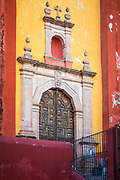 Templo de San Roque church in Guanajuato, Mexico<br /> ------<br /> Guanajuato is a city and municipality in central Mexico and the capital of the state of the same name. It is part of the macroregion of Bajío. It is in a narrow valley, which makes its streets narrow and winding. Most are alleys that cars cannot pass through, and some are long sets of stairs up the mountainsides. Many of the city's thoroughfares are partially or fully underground. The historic center has numerous small plazas and colonial-era mansions, churches and civil constructions built using pink or green sandstone.<br /> <br /> The origin and growth of Guanajuato resulted from the discovery of minerals in the mountains surrounding it. The mines were so rich that the city was one of the most influential during the colonial period. One of the mines, La Valenciana, accounted for two-thirds of the world's silver production at the height of its production.<br /> <br /> The city is home to the Mummy Museum, which contains naturally mummified bodies that were found in the municipal cemetery between the mid 19th and 20th centuries. It is also home to the Festival Internacional Cervantino, which invites artists and performers from all over the world as well as Mexico. Guanajuato was the site of the first battle of the Mexican War of Independence between insurgent and royalist troops at the Alhóndiga de Granaditas. The city was named a World Heritage Site in 1988.