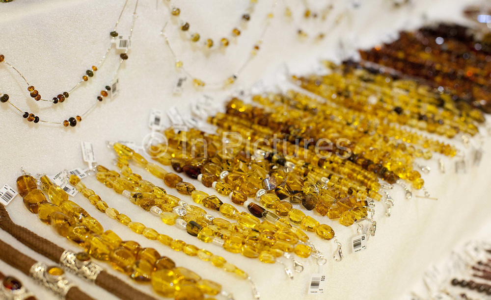 Amber jewellery for sale on display in a small boutique jewellers, San Cristobal de las Casas, Chiapas, Mexico.